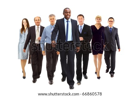 Happy businessman going in front of her team - stock photo