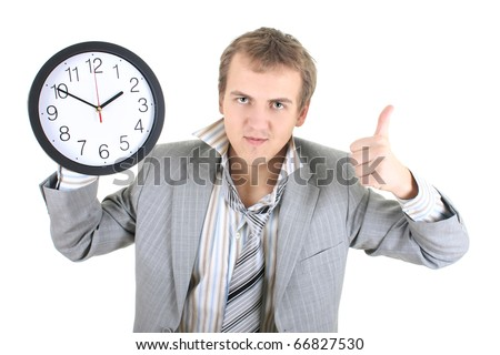 Happy businessman holding a clock over white