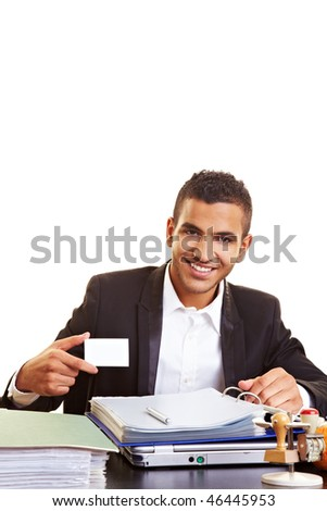 Happy businessman holding an empty business card