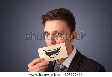 Happy businessman holding funny white card on his mouth with gradient background - stock photo