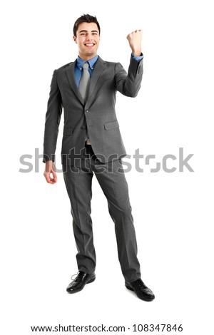Happy businessman in a victory pose - stock photo