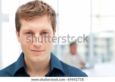 Happy businessman in his office at work - stock photo