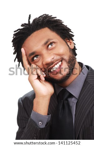 Happy businessman is busy day dreaming - stock photo