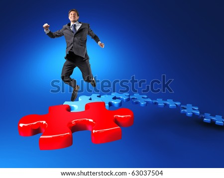 happy businessman jump on jigsaw stair