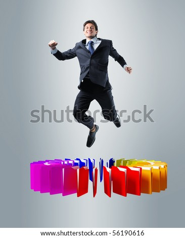 happy businessman jump over colorful 3d folder - stock photo