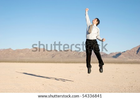 Happy businessman jumping in the air
