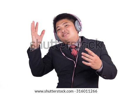 Happy businessman listening to music, business singing with loud music in the ears - stock photo