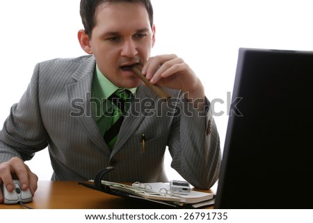 happy businessman looking at his laptop