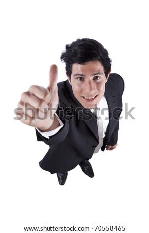 Happy businessman looking up and gesturing ok - stock photo