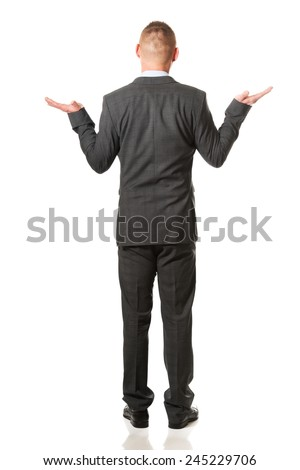 Happy businessman making presentation with both hands . - stock photo