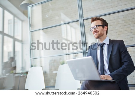 Happy businessman networking in office    - stock photo