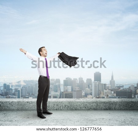 happy businessman on the roof - stock photo