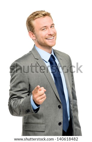 Happy businessman pointing on white background - stock photo