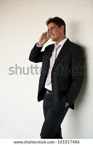 Happy businessman speaking on the cellphone - stock photo