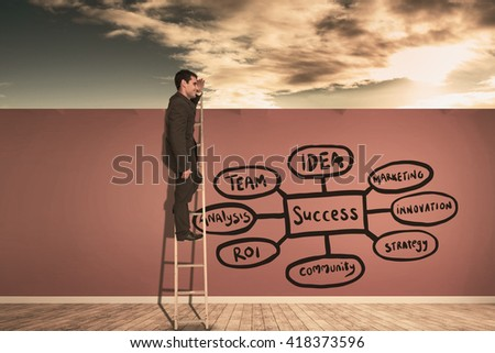 Happy businessman standing on ladder against room with wooden floor - stock photo