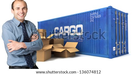 Happy businessman with a cargo container and boxes on the background - stock photo