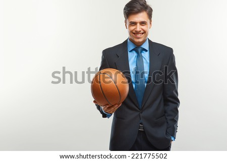 Happy Businessman with  ball against white background - stock photo