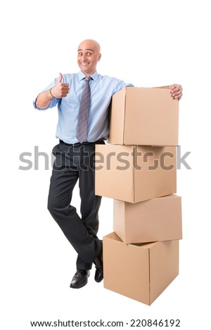 Happy businessman with cardboard boxes - stock photo
