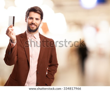 happy businessman with credit card - stock photo