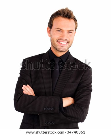 Happy businessman with crossed arms looking at the camera