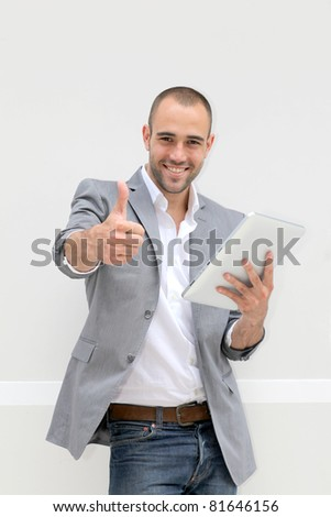 Happy businessman with electronic tablet - stock photo