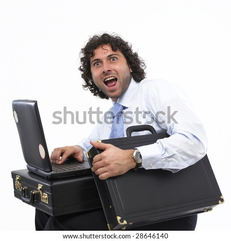 Happy businessman with laptop isolated on white background