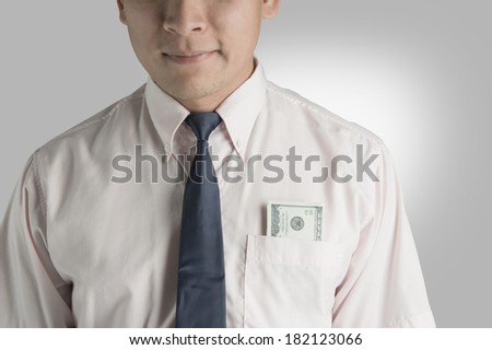 Happy businessman with money dollar in pocket. - stock photo