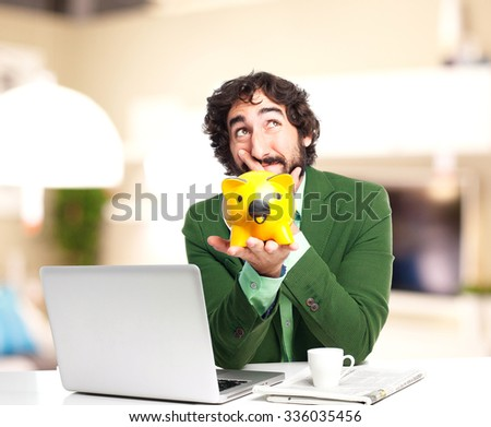 happy businessman with piggy bank - stock photo