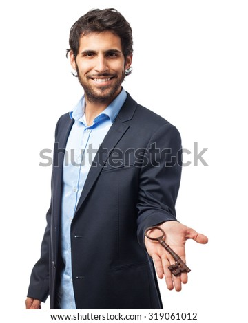 happy businessman with vintage key - stock photo