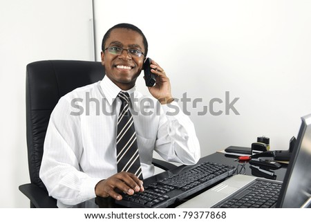 Happy businessman working at desk smiling