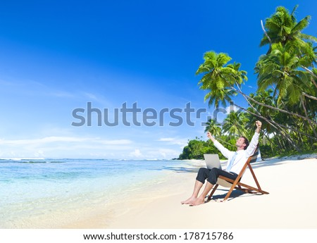 Happy Businessman Working on a Tropical Beach  - stock photo