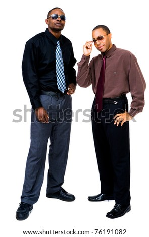 Happy businessmen posing together isolated over white