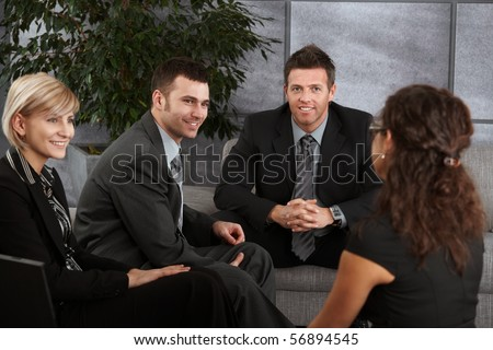 Happy  businesspeople having break, resting on sofa, talking.?