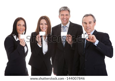 Happy Businesspeople Holding Visiting Card Over White Background - stock photo