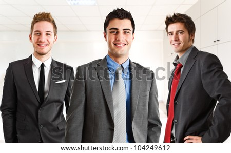 Happy businesspeople in their office
