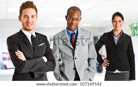 Happy businesspeople in their office - stock photo