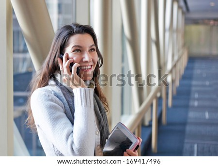 Happy businesswoman calling by cellphone - stock photo