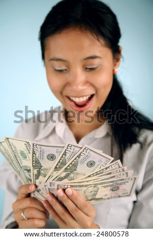 Happy businesswoman counting her money