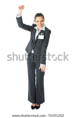 happy businesswoman dance, attractive brunette in grey suit isolated on white background