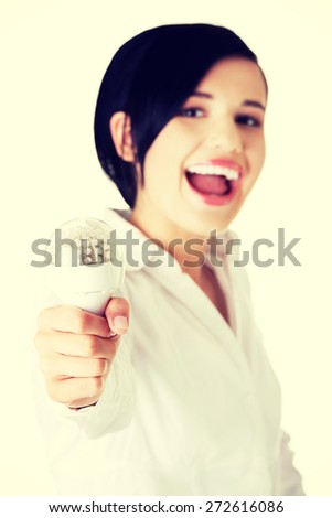 Happy businesswoman holding a bulb - stock photo