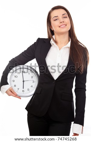 Happy businesswoman holding a clock isolated on white