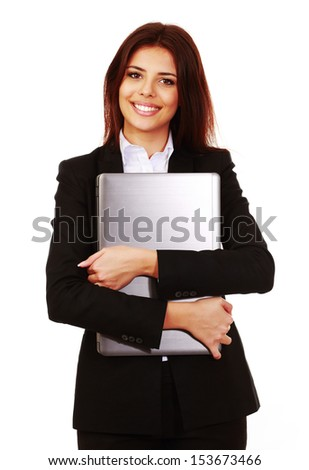 Happy businesswoman holding her laptop isolated on white - stock photo