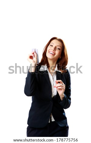 Happy businesswoman holding paper plane isolated on a white background - stock photo