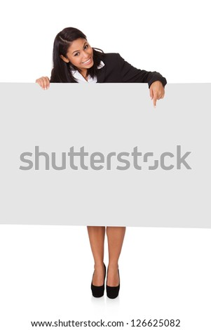 Happy Businesswoman Holding Placard. Isolated On White - stock photo
