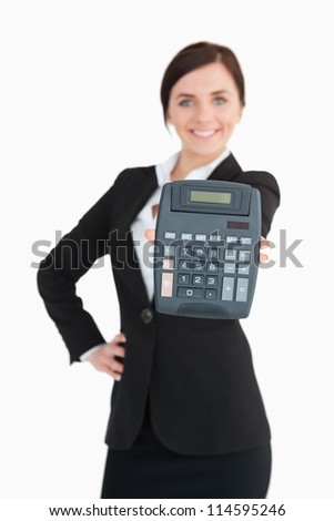 Happy businesswoman in black suit showing a calculator against white background