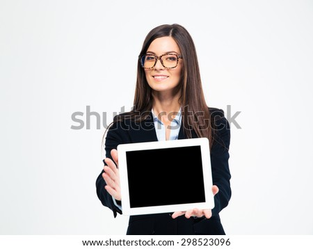 Happy businesswoman in glasses showing tablet computer screen isolated on a white background - stock photo