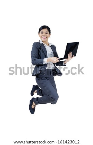 Happy businesswoman jumping with a notebook, isolated on white background - stock photo
