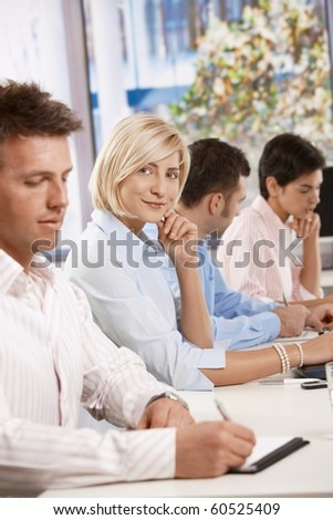 Happy businesswoman on business meeting, leaning on table, looking at camera and smiling.?