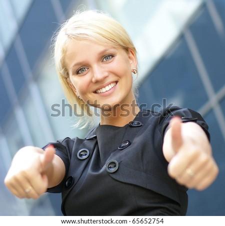Happy businesswoman over urban background - stock photo
