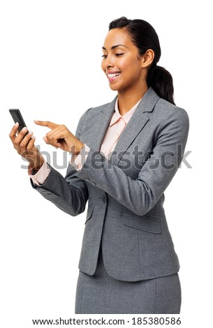 Happy businesswoman reading text message on smart phone over white background. Vertical shot. - stock photo
